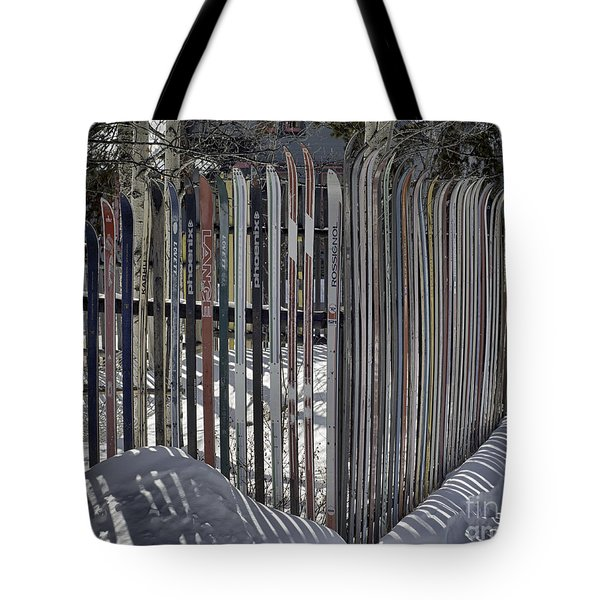 Tote Bag featuring the photograph Ski Fence by Bitter Buffalo Photography