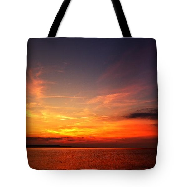 Tote Bag featuring the photograph Skies On Fire by Baggieoldboy