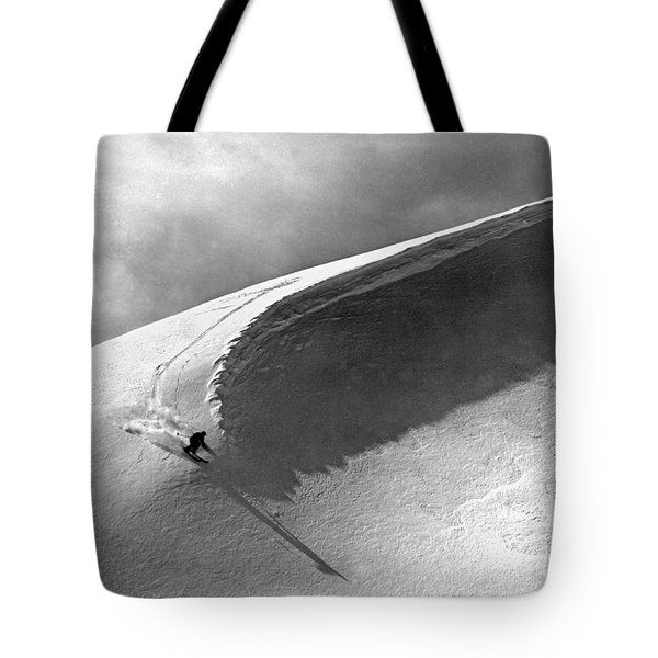 Skiing Under A Curl Tote Bag by Underwood Archives