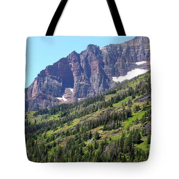 Sloping Mountain At Two Medicine Lake Tote Bag by Carol Groenen