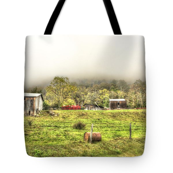 Smalll West Virginia Farm Coming Out Of Clouds Tote Bag by Dan Friend