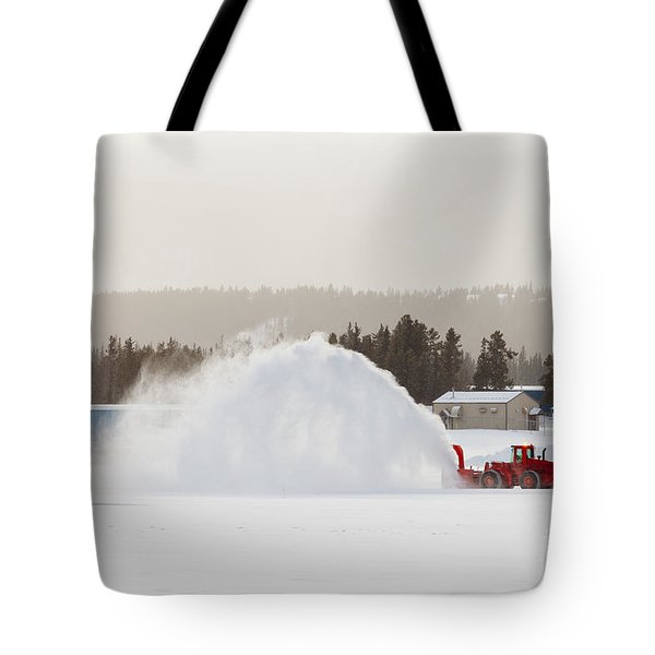 Snow Blower Clearing Road In Winter Storm Blizzard Tote Bag by Stephan Pietzko