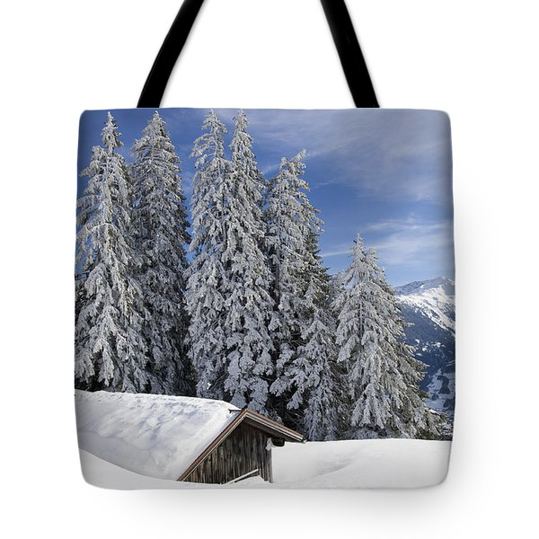 Snow Covered Trees And Mountains In Beautiful Winter Landscape Tote Bag by Matthias Hauser
