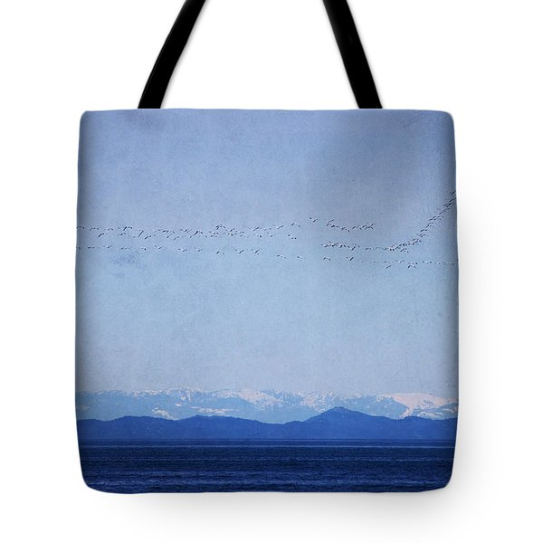 Tote Bag featuring the photograph Snow Geese Over The Ocean by Peggy Collins