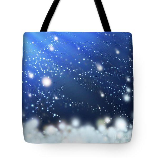 Snow In The Wind Tote Bag by Atiketta Sangasaeng