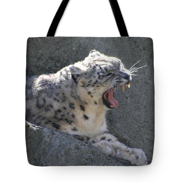 Snow Leopard Yawn Tote Bag by Neal Eslinger