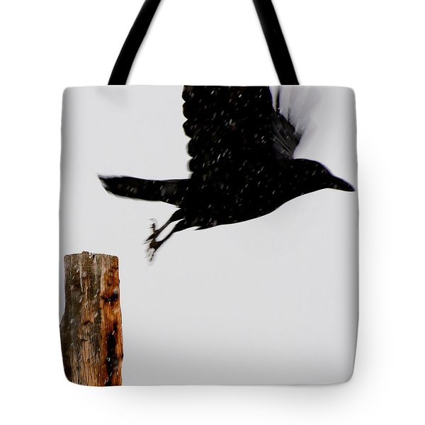 Tote Bag featuring the photograph Snow Raven Blurr by Britt Runyon