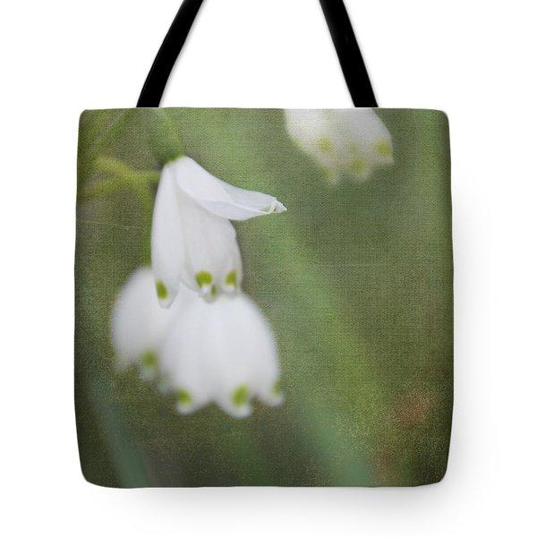 Tote Bag featuring the photograph Snowdrops by Katie Wing Vigil