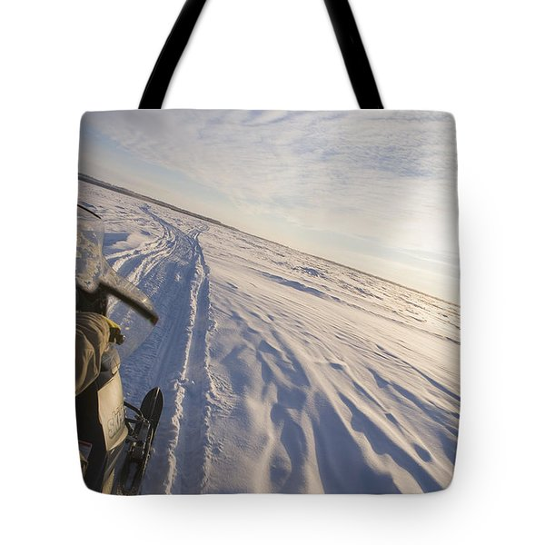 Snowmachiner Following Trail On Frozen Tote Bag by Kevin Smith