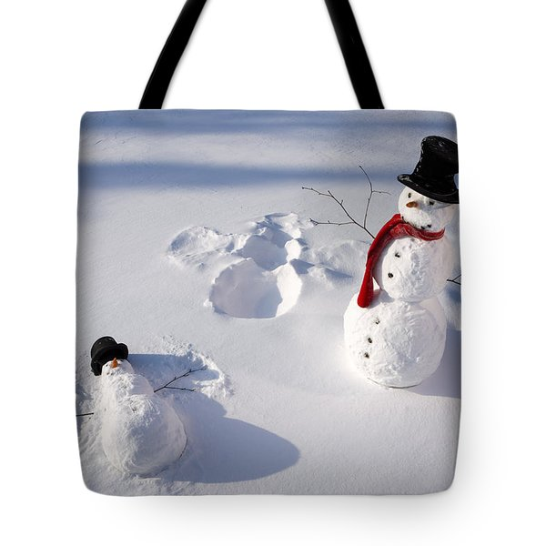 Snowmen In Forest Making Snow Angel Tote Bag