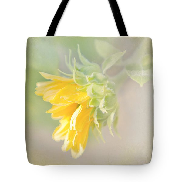 Tote Bag featuring the photograph Soft Yellow Sunflower Just Starting To Bloom by Patti Deters