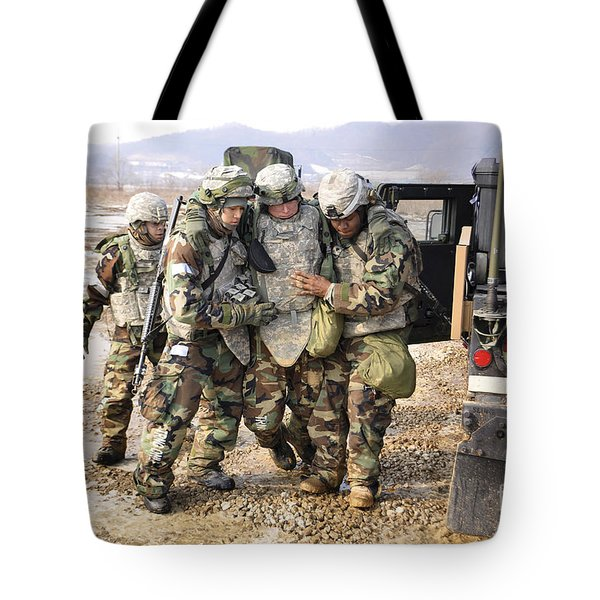 Soldiers Conduct Medical Evacuation Tote Bag by Stocktrek Images