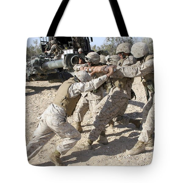 Soldiers Move The Muzzle-end Of A M777 Tote Bag by Stocktrek Images