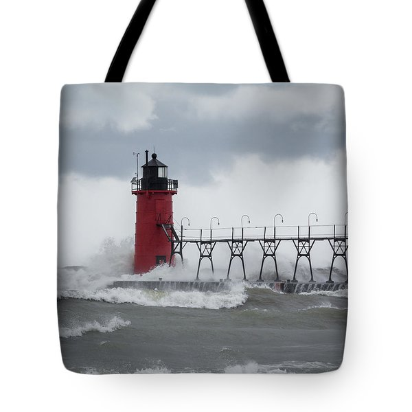 South Haven Pier Light In A Storm Tote Bag