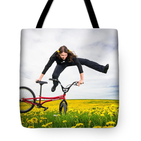 Spring Has Sprung - Bmx Flatland Artist Monika Hinz Jumping In Yellow Flower Meadow Tote Bag by Matthias Hauser