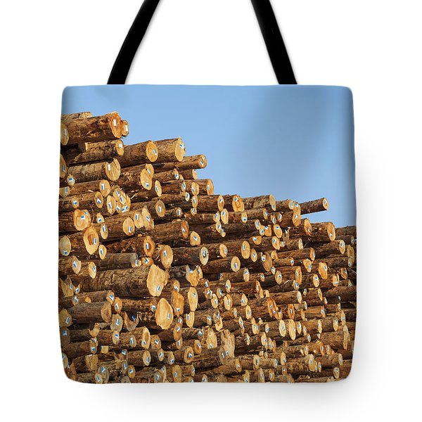 Tote Bag featuring the photograph Stacks Of Logs by Bryan Mullennix