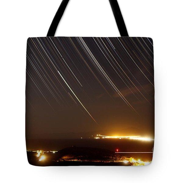 Star Trails Above A Village Tote Bag by Amin Jamshidi