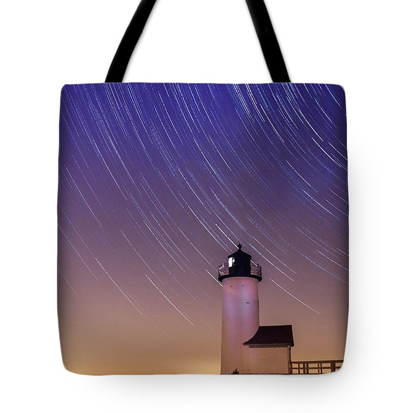 Tote Bag featuring the photograph Stars Trailing Over Lighthouse by Jeff Folger
