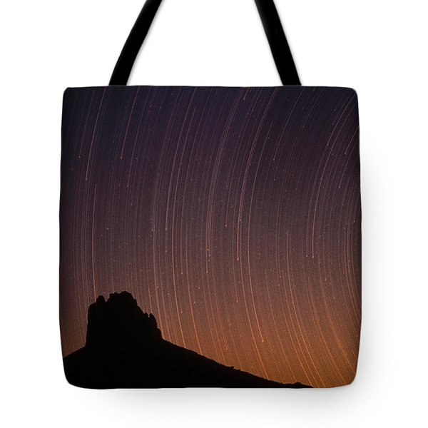 Startrails Over Shiprock In The Four Tote Bag by Tim Fitzharris
