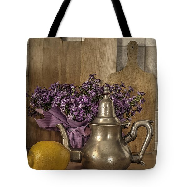 Tote Bag featuring the photograph Still Life With Purple Flowers And Citron by Julis Simo