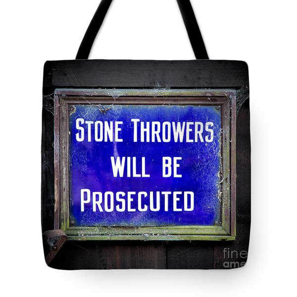 Tote Bag featuring the photograph Stone Throwers Be Warned by Adrian Evans