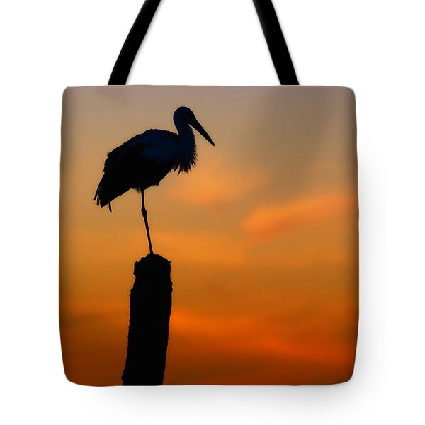 Storck In Silhouette High On A Pole Tote Bag
