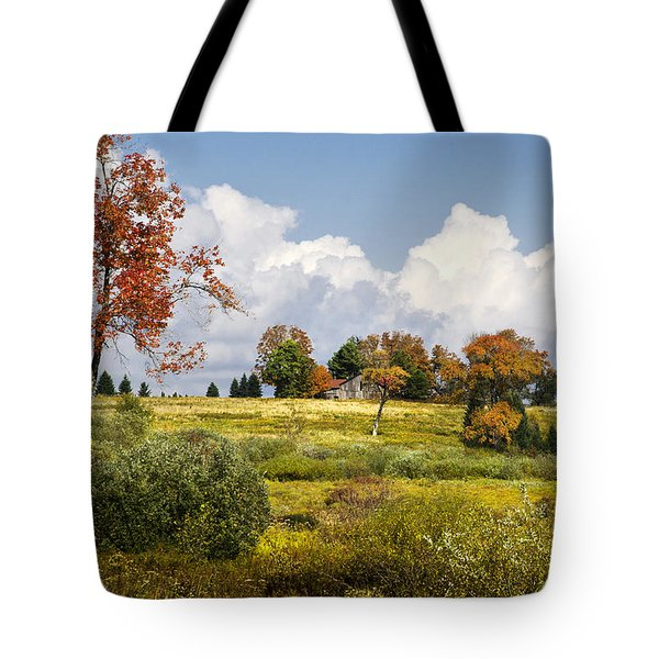 Tote Bag featuring the photograph Storm Clouds Over Country Landscape by Christina Rollo