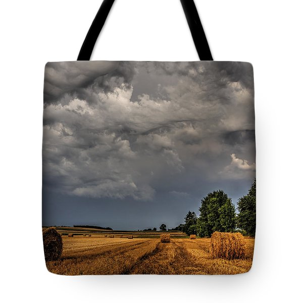 Storm Clouds Over Harvested Field In Poland 2 Tote Bag