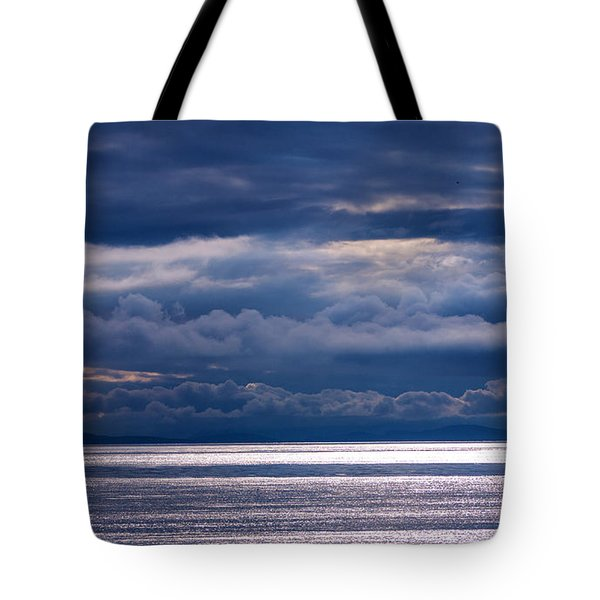 Tote Bag featuring the photograph Storm Supremacy by Jordan Blackstone
