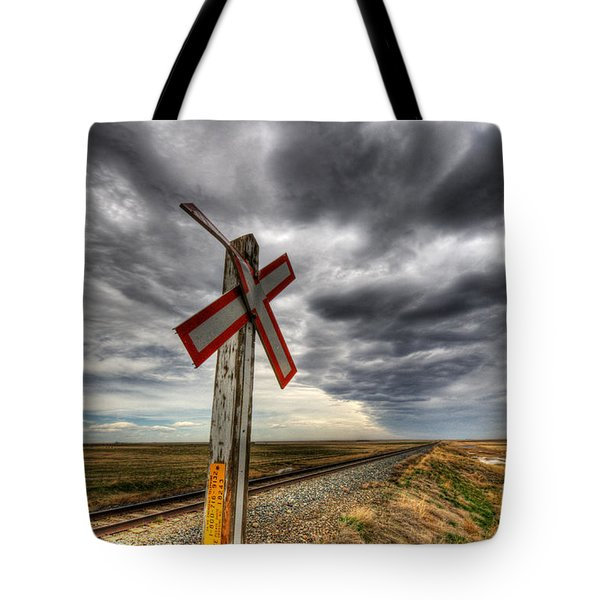 Stormy Crossing Tote Bag by Bob Christopher
