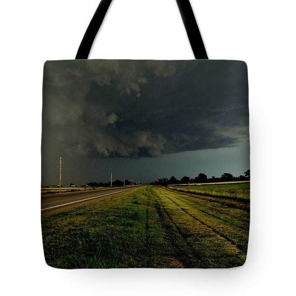 Tote Bag featuring the photograph Stormy Road Ahead by Ed Sweeney