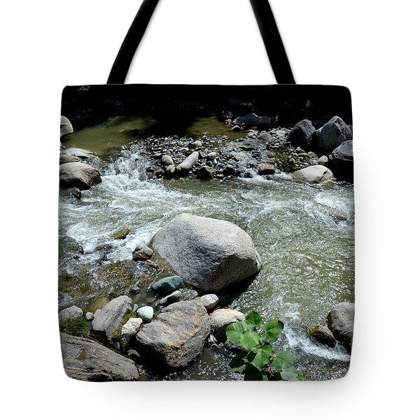 Tote Bag featuring the photograph Stream Water Foams And Rushes Past Boulders by Imran Ahmed
