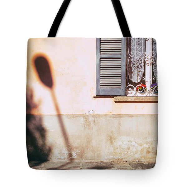 Tote Bag featuring the photograph Street Lamp Shadow And Window by Silvia Ganora