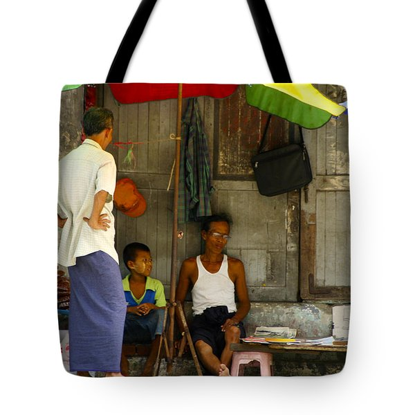 Street Seller Sitting In The Shade Under An Umbrella Yangon Myanmar Tote Bag by Ralph A  Ledergerber-Photography