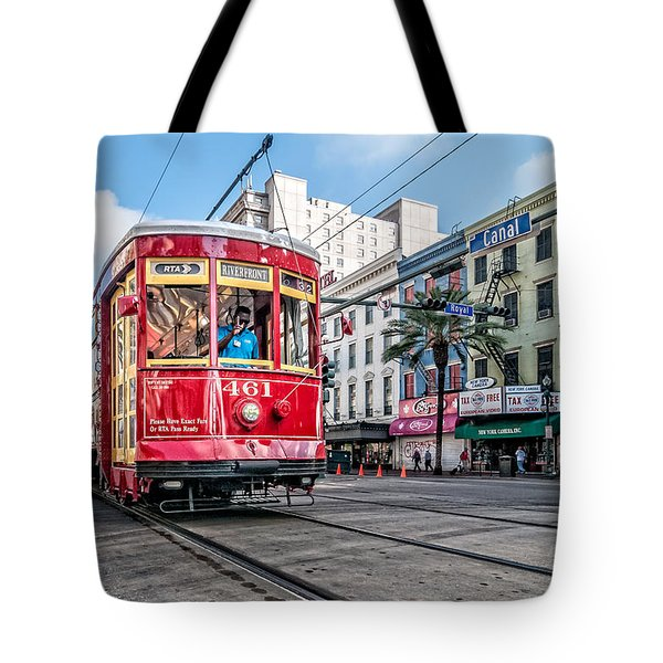 Tote Bag featuring the photograph Streetcar At The Corner Of Canal And Royal by Andy Crawford