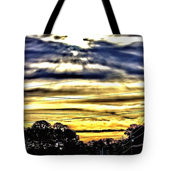 Tote Bag featuring the photograph Sun Burst by Tyson Kinnison