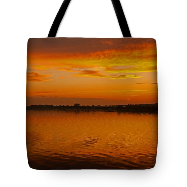 Tote Bag featuring the pyrography Sun Going Down In Jastarnia by Julis Simo