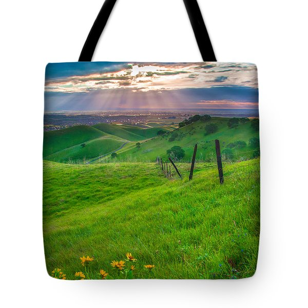 Sun Rays And Green Hillside Tote Bag by Marc Crumpler