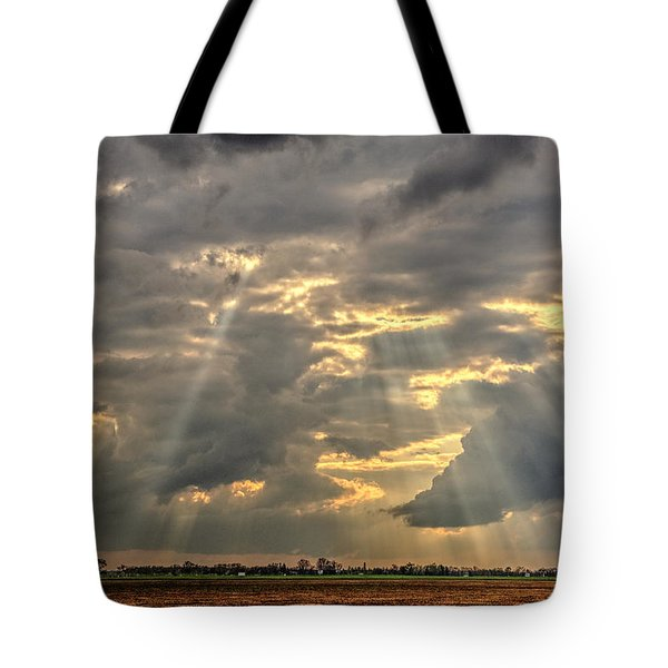 Tote Bag featuring the photograph Sun Rays Over A Field by Julis Simo