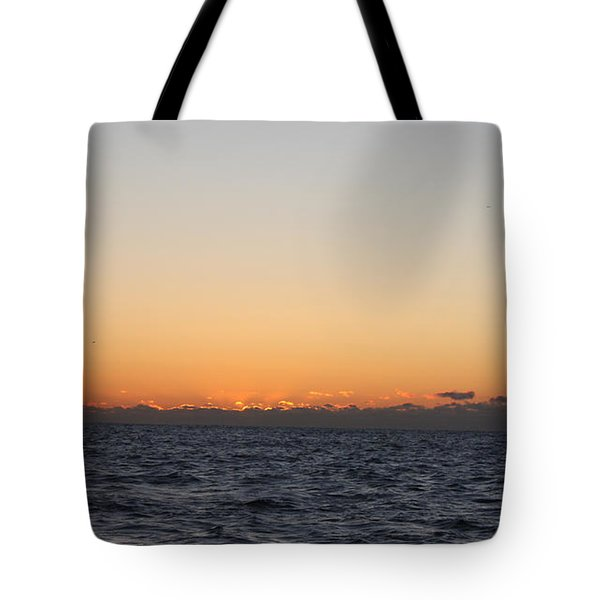 Sun Rising Above Clouds And Horizon Tote Bag by John Telfer