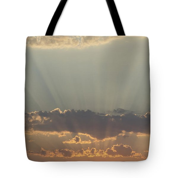 Sunlight Shining Through Clouds And Tote Bag by Keith Levit