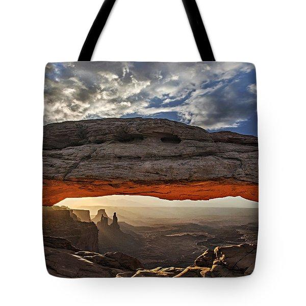 Sunrise At Mesa Arch Tote Bag by Roman Kurywczak