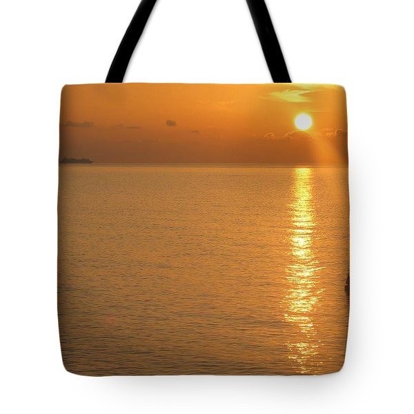 Tote Bag featuring the photograph Sunrise At Sea by Photographic Arts And Design Studio