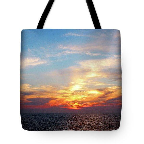 Sunrise At Sea Tote Bag by Susan Savad