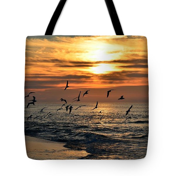 Tote Bag featuring the photograph Sunrise Colors Over Navarre Beach With Flock Of Seagulls by Jeff at JSJ Photography