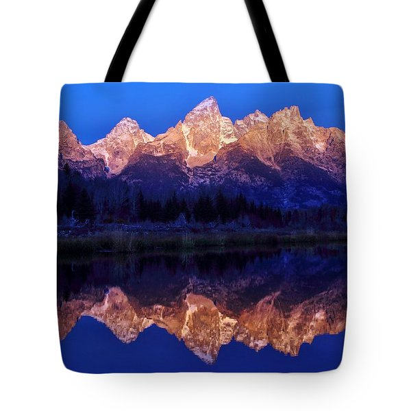 Tote Bag featuring the photograph Sunrise Glow by Benjamin Yeager
