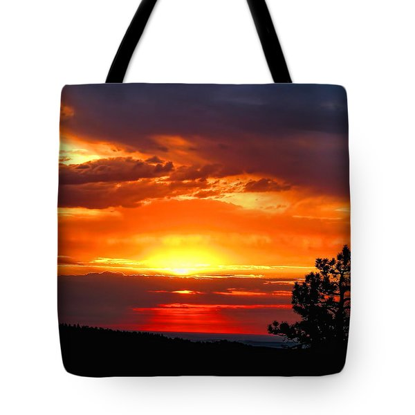 Tote Bag featuring the photograph Sunrise Over Keystone by Dale Kauzlaric