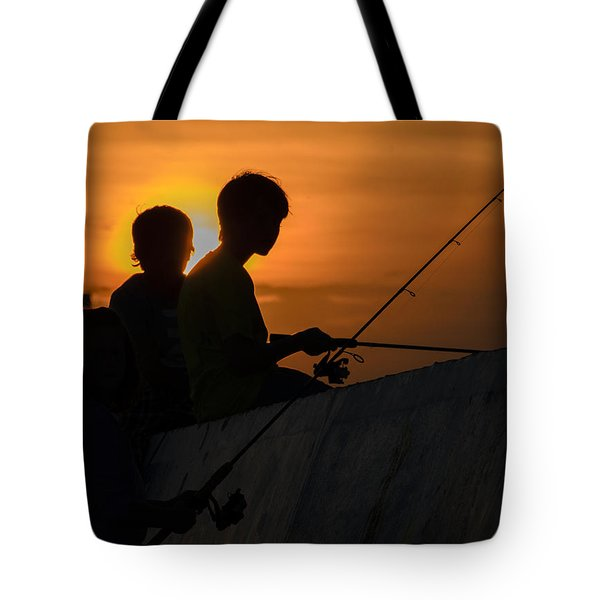 Sunset Anglers Tote Bag by Keith Armstrong