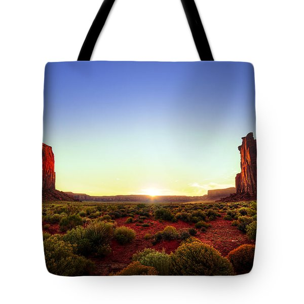 Sunset In Monument Valley Tote Bag by Alexey Stiop