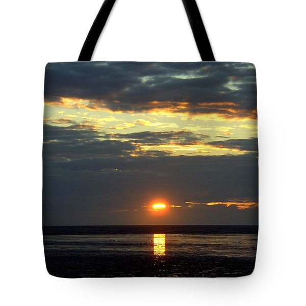 Sunset On A Cloudy Evening Tote Bag